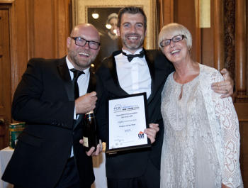 Paul Hughes from Pam Ties Ltd presenting their award to Tim and Jane Herbert.