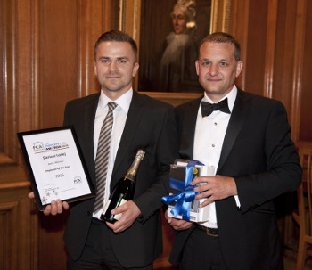Dariusz Lodej receiving his award from Stephen Hodgson Chief Executive of the PCA